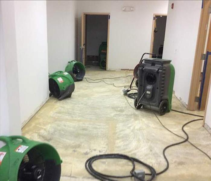 drying equipment, concrete pad floor, carpet removed doors shown