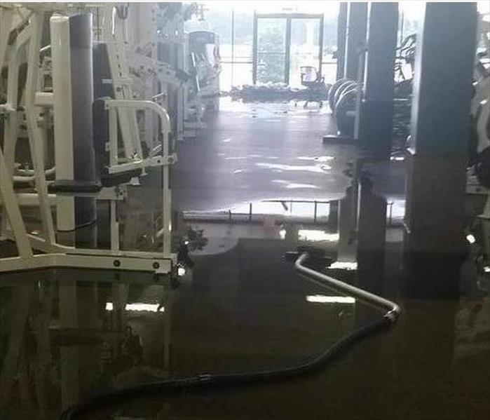 sandbags at front entrance, flooded fitness center floor