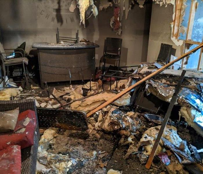 fallen ceiling material, insulation, burnt items, messed furniture